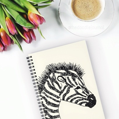 Ink drawing featured on spiral notebooks sold at online shop